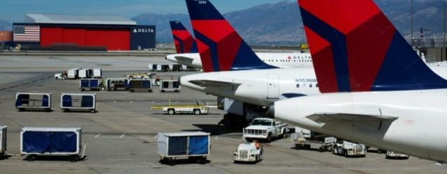 delta-planes-line-up-at-their-gates-while-on-the-tarmac-of-salt